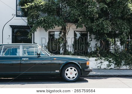 London, Uk - August 1, 2018: Old Green Bentley Parked In Front Of A House In Barnes, London. Barnes