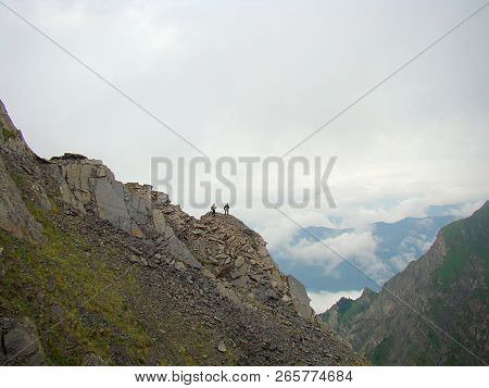 Caucasus Mountains, Fighting The Top Of The Mountain With Fogcaucasus Mountains, Fighting The Top Of