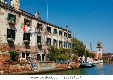 View Of Houses And Canal Street With Bridge In The Old Town Arsenal Venice Italy