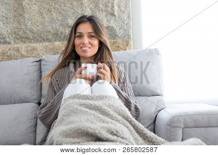 A Beautiful Young Woman Relaxing At Home