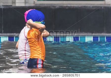 Asian Sibling Are Playing In Swimming Pool