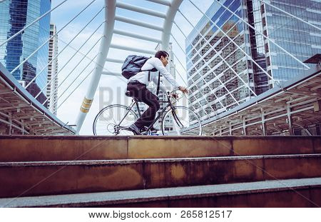 Healthy Business Man Riding His Bicycle To Work In A Modern City