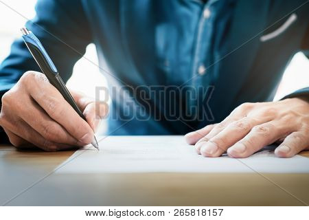 Close Up Businessman Signing Contract Making A Deal