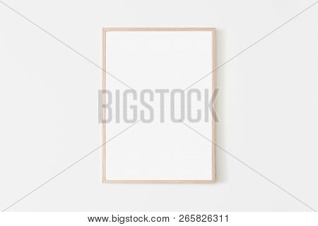 Portrait Large 50x70, 20x28, A3, A4, Wooden Frame Mockup On White Wall. Poster Mockup. Clean, Modern