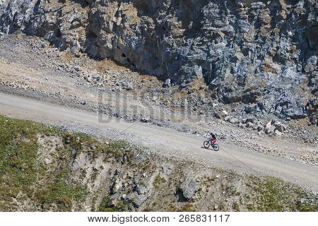 Cyclist In France Ride Bicycle Uphill. Hot Summer Day In Les Deux Alpes