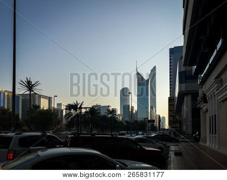 Abu Dhabi, Uae - October 27, 2018: Beautiful Shot Of Abu Dhabi City Street, Towers And Wtc At Sunset