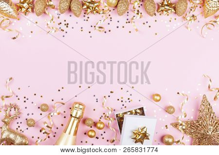 Christmas Background With Golden Gift Or Present Box, Champagne And Holiday Decorations On Pink Past