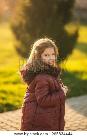 Girl Model In Jaket Poses To Photo