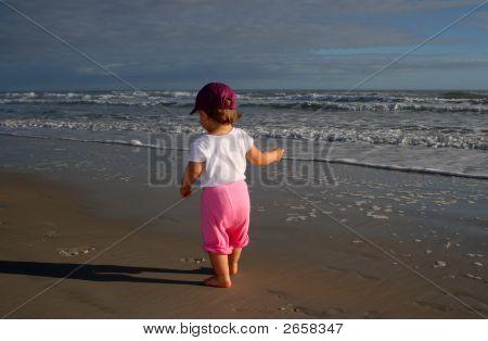 Baby Girl Walking On The Beach