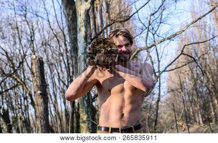 Hermit Lifestyle. Man Brutal Sexy Lumberjack Carry Big Log On Shoulder. Man Brutal Strong Attractive