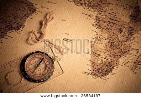 compass on old world map.