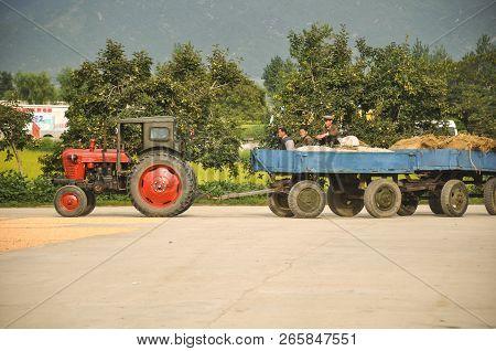 09/08/18, Hamhung, North-korea: A North Korean Propaganda Planned Economy Site With A Tractor Arrivi