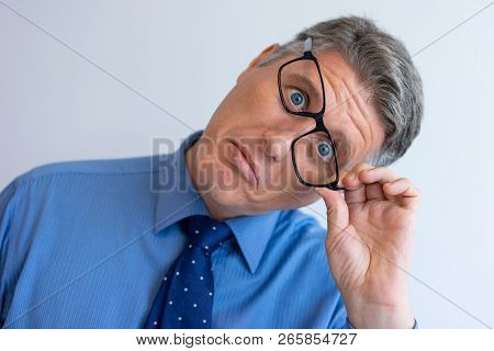 Crazy Businessman Fooling At Camera. Closeup Of Middle Aged Caucasian Man Touching Askew Glasses And