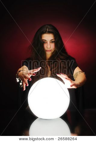 Fortuneteller with magic sphere