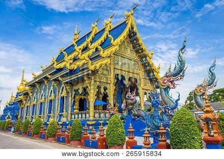 Wat Rong Sua Ten Temple With Blue Sky Background, Chiang Rai Province, Thailand, It's A Popular Dest