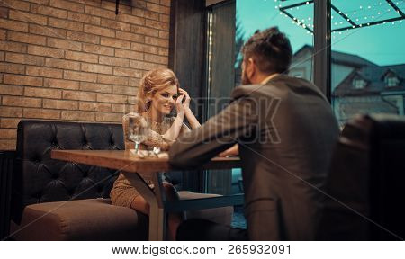 Couple In Love At The Restaurant. Date Of Family Couple In Romantic Relations, Love. Business Meetin