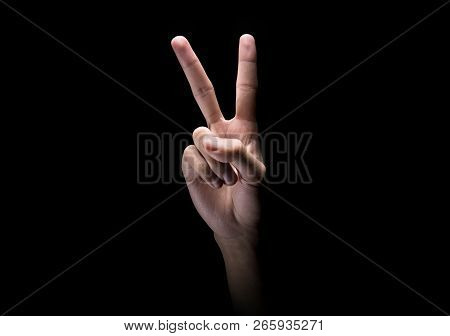 Male Hands With Two Finger Sign Or Peace Gesture Over Dark Background