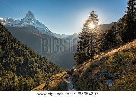 Famous Matterhorn Peak Against Sunset In Zermatt Area, Switzerland
