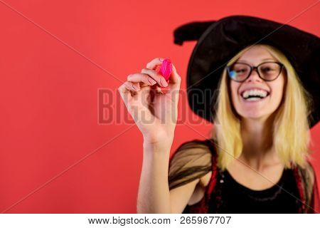 Girl In Witch Dress With Marker In Hand. Writing With Pen. Halloween Witch. Halloween Concept. Woman
