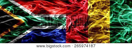 South Africa Vs Guinea, Guinean Smoke Flags Placed Side By Side. Concept And Idea Flags Mix