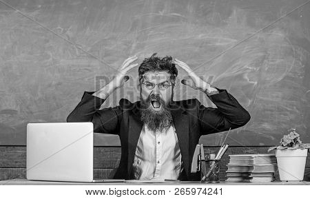 What Stupid Thought. Man Bearded Teacher Aggressive Expression Sit Classroom Chalkboard Background.