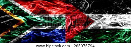 South Africa Vs Palestine, Palestinian Smoke Flags Placed Side By Side. Concept And Idea Flags Mix