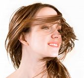 Woman's hair are being blown away in a swirling wind poster