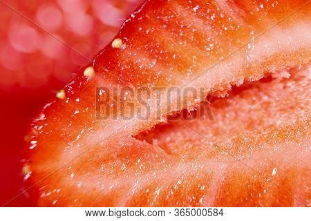 Strawberry Background. Blurred Natural Red Background. Texture Of Strawberry Berries. Beautiful Slic