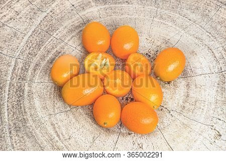 A Hill Of Fresh Kumquat Fruits Is A Small Citrus That Is The Size Of Walnuts. It Is Also Called The