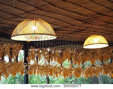 Lighting Bulb In The Rattan Cover Lamps, Concept Of Creativity.