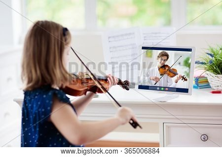 Child Playing Violin. Remote Learning From Home. Arts For Kid. Little Girl With Musical Instrument