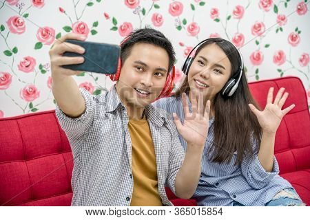 Asian Vlogger Of Married Couple Taking Video And Stream Live To Attendee Via Mobile Phone By Social