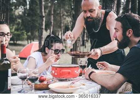People Eating Food In Nature. Happy People Lifestyle. Friends Having Lunch In Nature. Nature Lifesty
