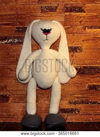 White Rabbit. White Stuffed Toy. Knitted Toy With Your Own Hands. Rabbit Without Clothes.