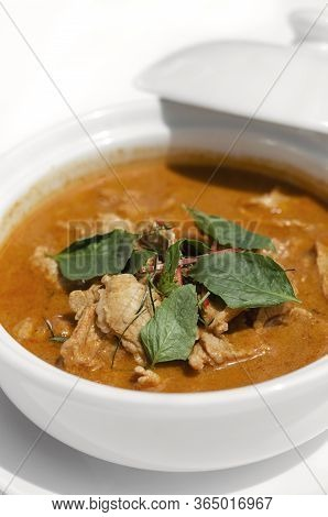 Thai Spicy Panang Pork Curry With Coconut Milk On White Table In Phuket Thailand