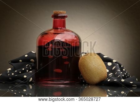 Still Life With Ripe Green Kiwifruit, Black And White Napkin And Vintage Glass Bottle With Homemade