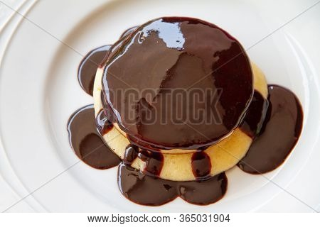 Pancake  Top View Topped With Chocolate On A White Plate
