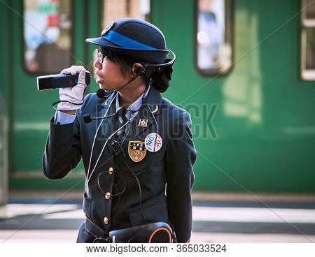 Kyoto / Japan - November 3, 2017: Female Train Station Officer Announcing The Departure Of The Train