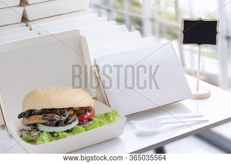 Crickets Insect In Bread Burger For Eating As Food In Packaging For Take-out Food Or Order Online An