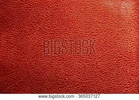 Orange Faux Leather. Faux Leather Texture Close Up With Streaks