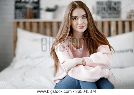 Pretty Female With Fair Hair, Dressed Casually, Looking With Satisfaction At Camera, Being Happy. Ho