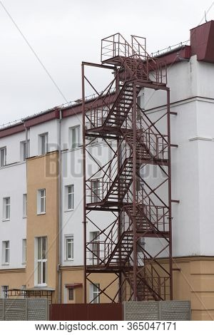 Fire Escape, Red Metal Staircase, Emergency Exit On Side Of Building
