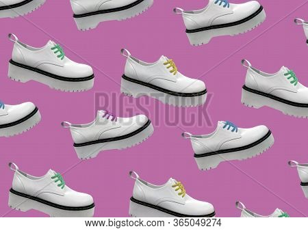White Leather Platform Shoes Isolated On Pink Background. Classic Shoes On A High Black Tractor Plat