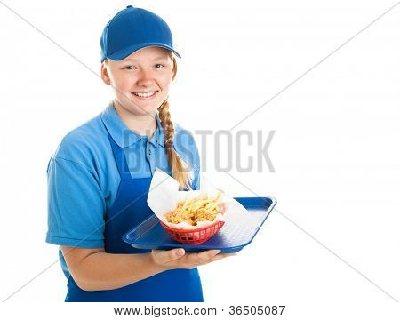 Teenage fast food worker holding a tray of chicken nuggets and fries.  Isolated on white.