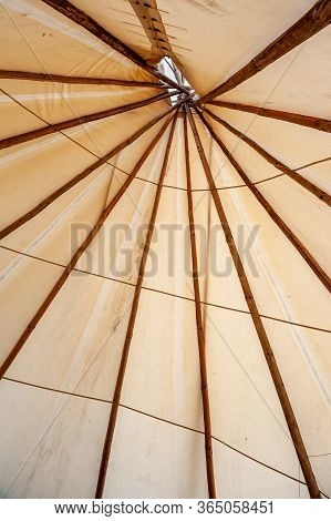 Close Up Of Teepee Tent Top Made Of Canvas And Wood Beams. Tee Pee Tent Set Up For Camping. Interior
