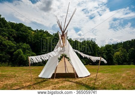 Beautiful View Of The Summer Wedding Tipi In A Field. Tee Pee Built On Green Grass. Traditional Teep