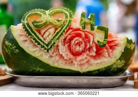 Carved Watermelon Floral Decoration With Heart And Letters. The Art Of Fruits And Vegetable Carving.