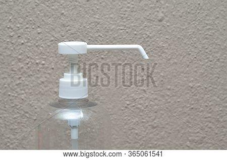 A White Nozzle On A Plastic Bottle