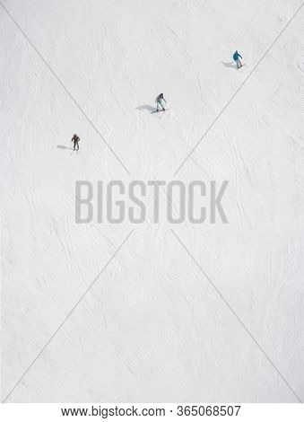 Art And Artistic View Of Three Freeride Snowboarders And Skier