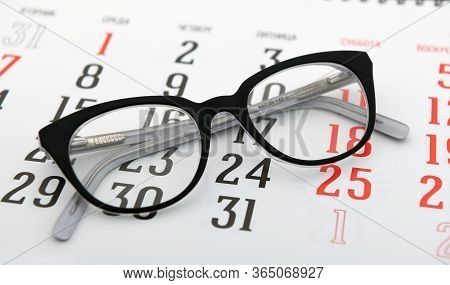 Glasses Are On The Calendar.tax Day, Calendar, Glasses.